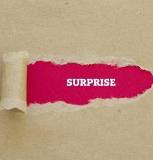 Surprise,Word,Written,Under,Torn,Paper.